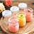 Wholesale 100ml Round Empty Storage Container Milk Pudding Bottle Glass Yogurt Jars with Plastic Lid