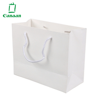 Custom Logo clothing packaging white paper shopping bag With Ribbon
