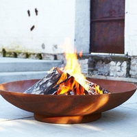 Freestanding metal fire pit bowl with deep wood burning