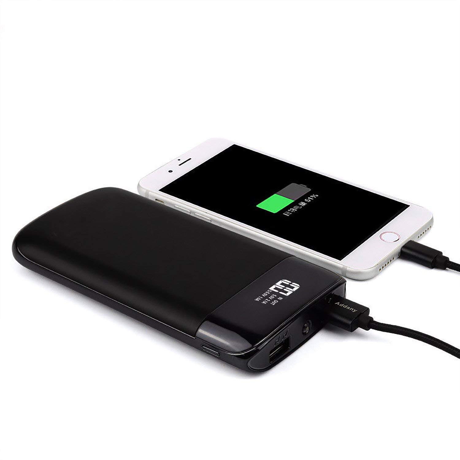 Iphone portable battery charger cutting tile on wall
