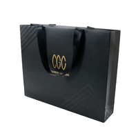OEM Custom Luxury Shopping Bag Black Hot Foiled Art Coated Paper Bag With PP Handle Rope