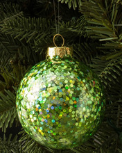 Handmade green glass Christmas hanging ball with sequins stick to the surface