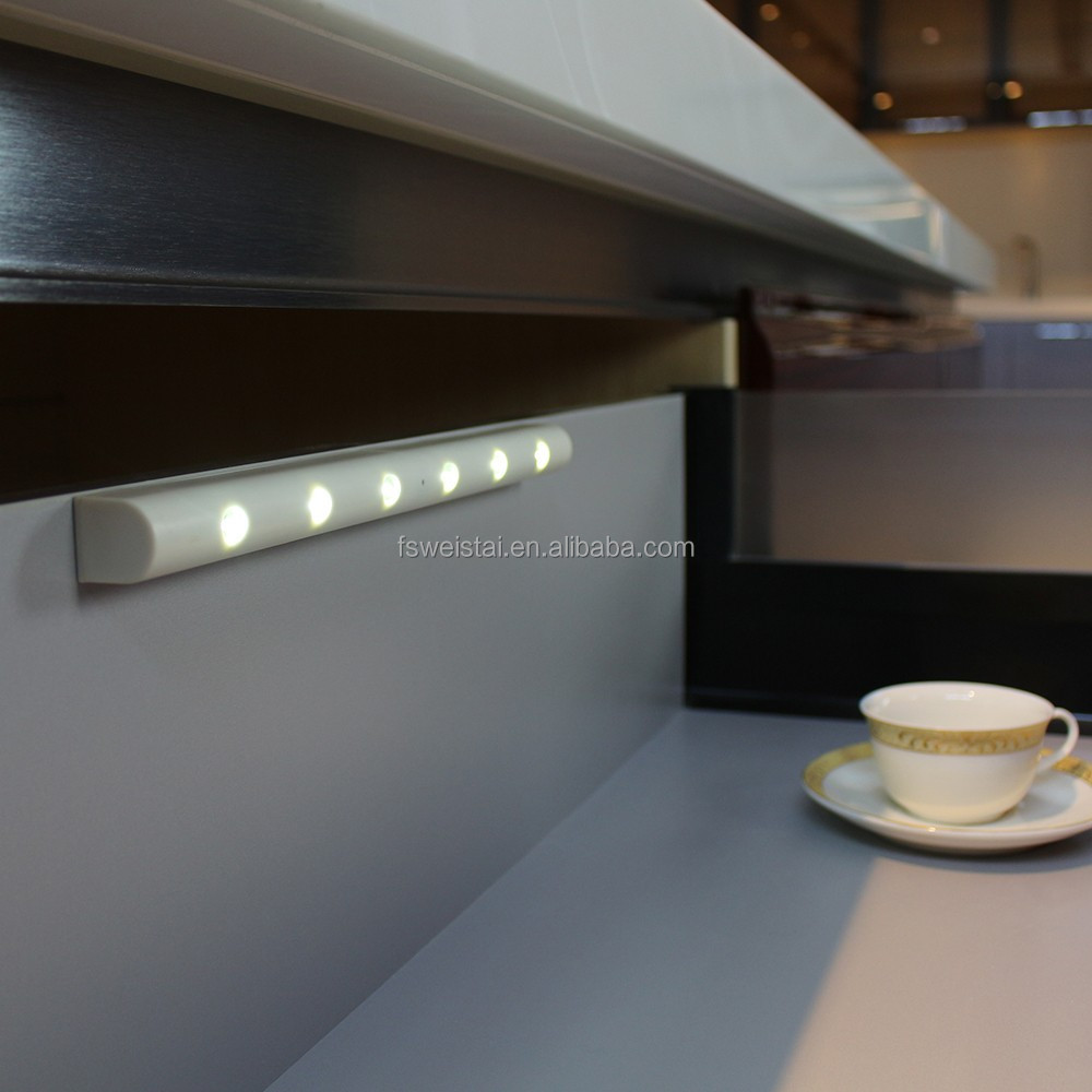 https://sc02.alicdn.com/kf/HTB10vIzNFXXXXaTXpXXq6xXFXXXm/ABS-under-kitchen-cabinet-sensor-light-cupboard.jpg