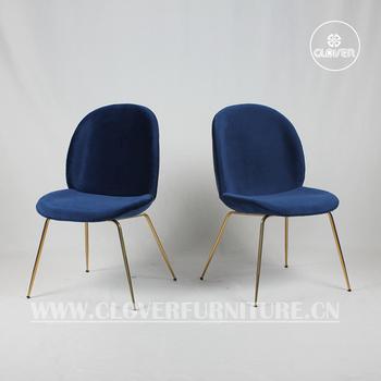 replica beetle chair dark blue velvet gold legs