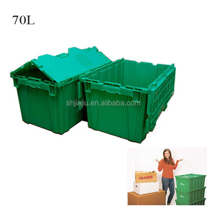 Green plastic moving crates for warehouse storage