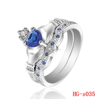 double hand with blue stone ring wedding engagement couple zircon rings