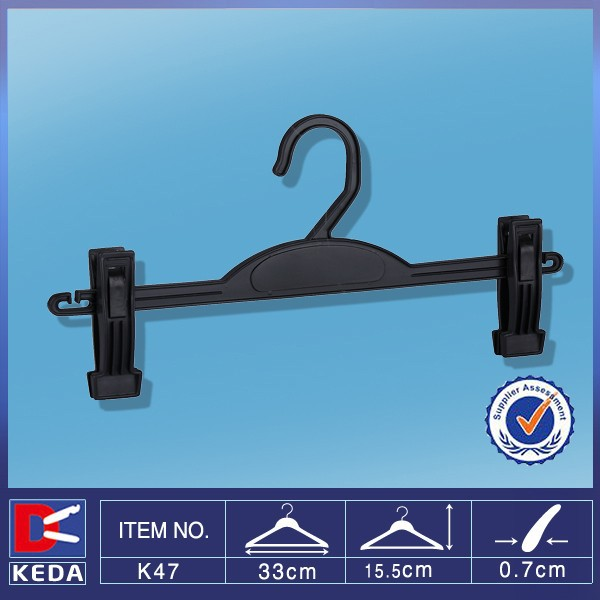 Hot sale plastic pants hanger with moved clips K47