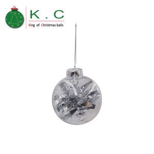 Christmas Tinsel Transparent.Transparent Silvery Tinsel Filled Christmas Ball