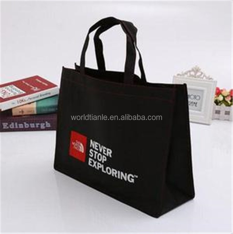 Printed non woven fabric material in packing bag with logo black nonwoven/non woven tote bag