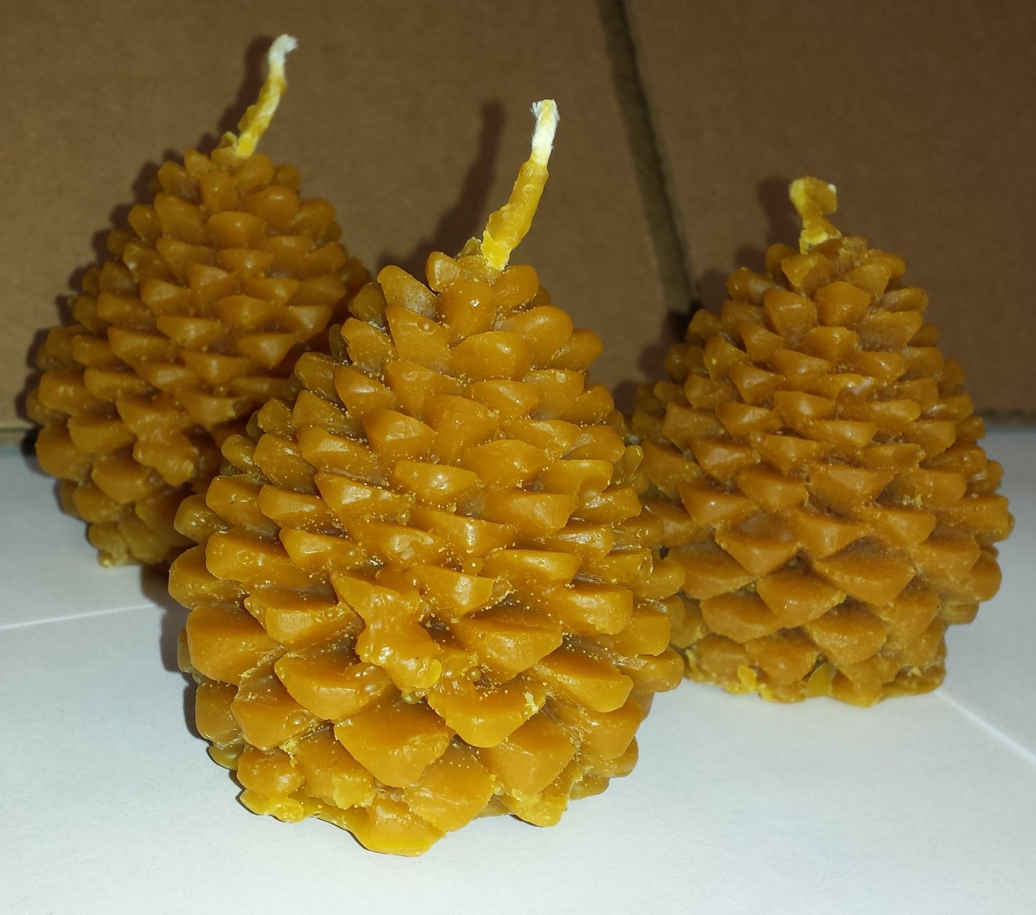 Hansi Naturals Beeswax Pinecone Candles: 3 Pack Golden-brown Pure Wax Long Clean Burning Pine Cone Candles From Hansi Naturals