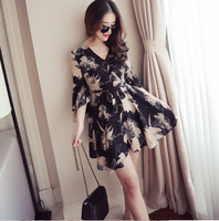 The new south Korean version of the trumpet sleeve v-neck printed chiffon dress with a high waist belt and a short skirt