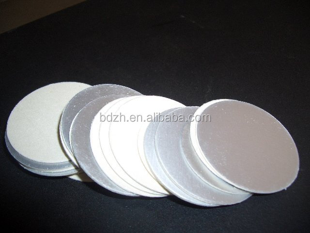Aluminum foil heat induction seal liner/lid with earn sealing film
