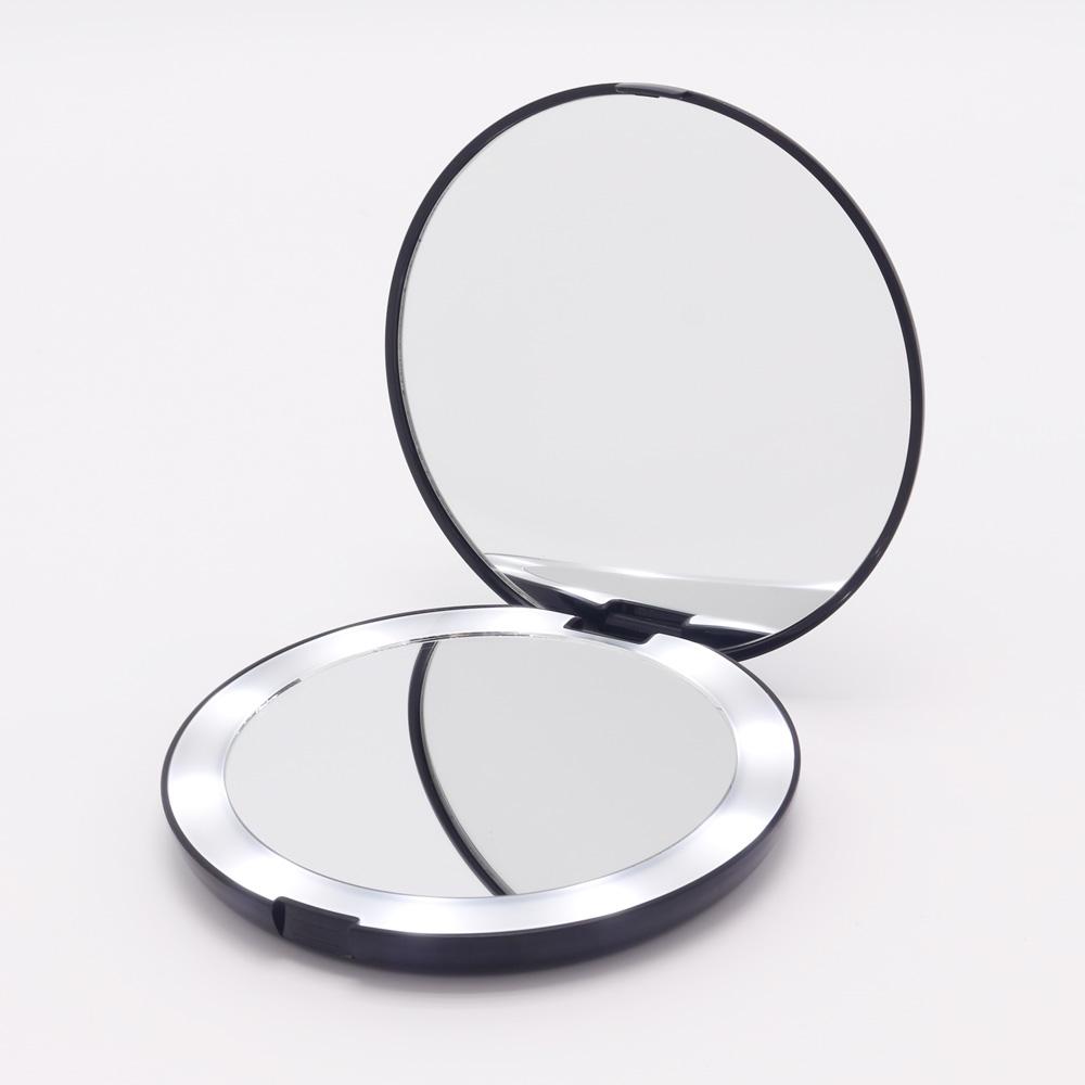 Double sided 7X ingrandimento illuminato da viaggio pieghevole compact led specchio per il trucco con le luci