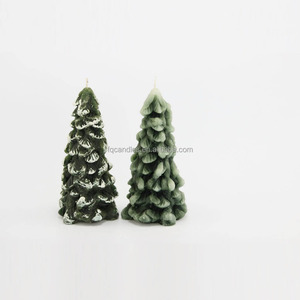 christmas tree shaped candle in different color and sizes