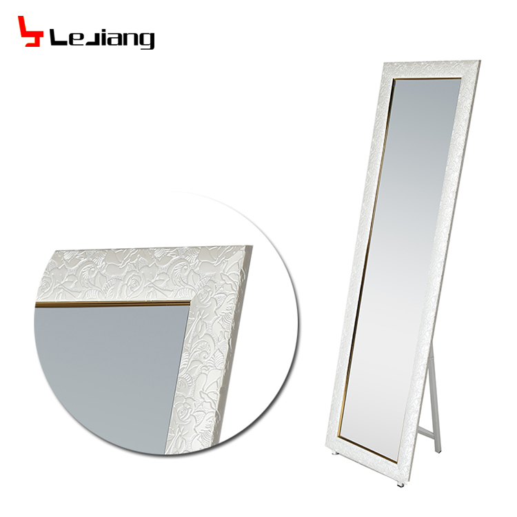 iron with shelf leaning mirror