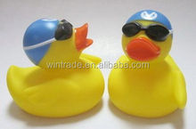 Swimming cap & sunglass duck floating on water