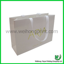 paper apparel packaging bag with ribbon