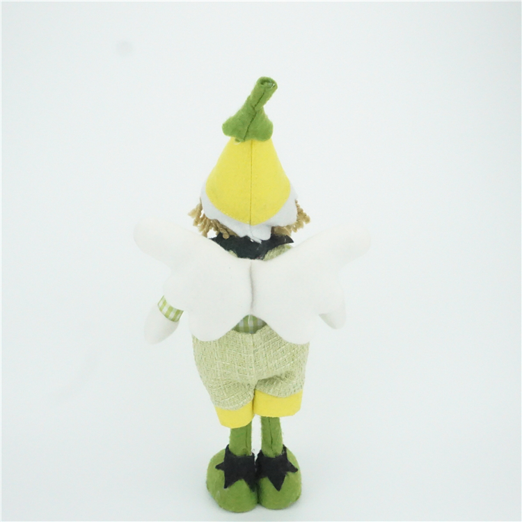 Christmas ornaments standing spring flower elf doll green girl fairy decorations on the shelf