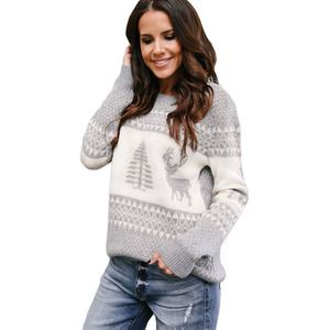 Woman clothing reindeer and christmas knitted sweater