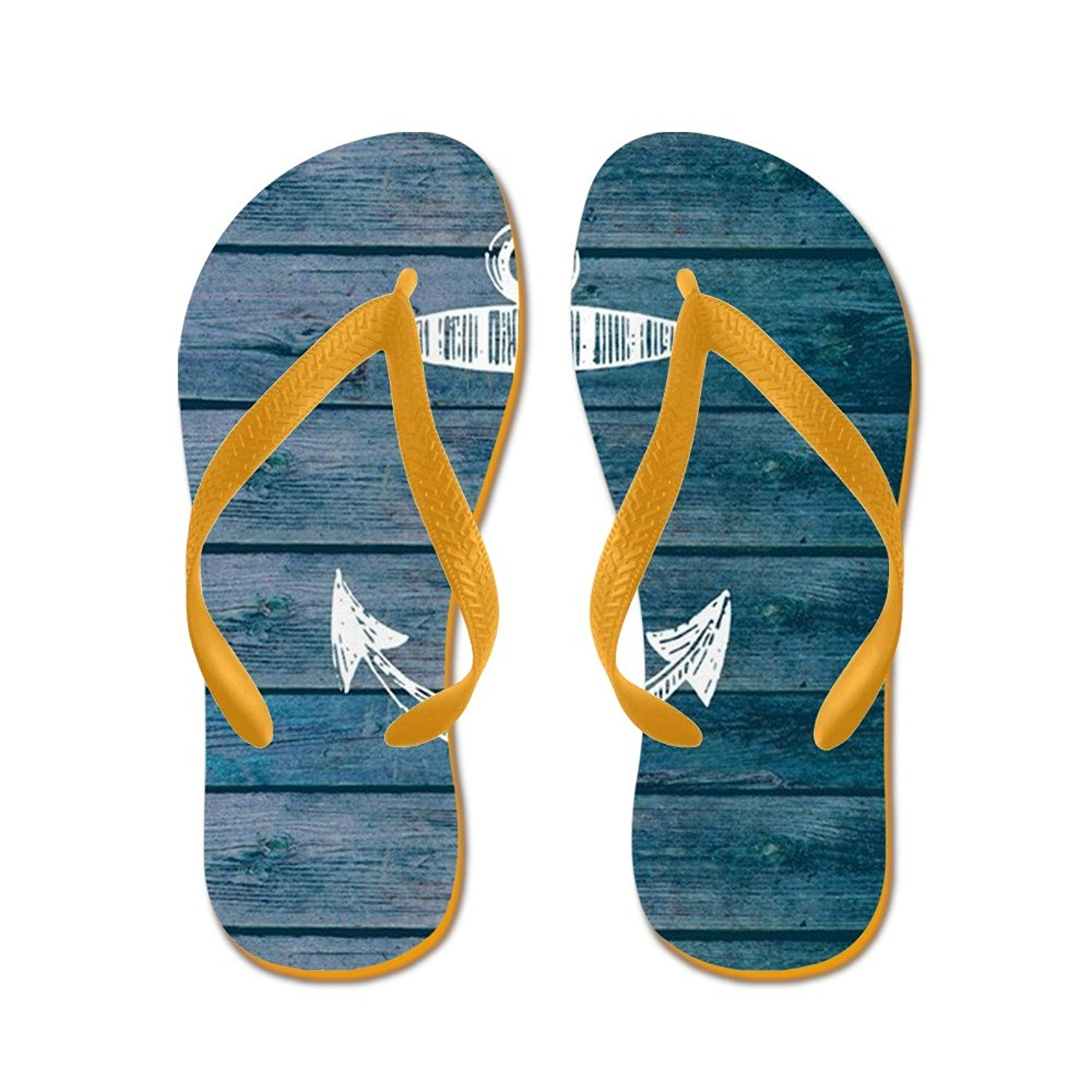 a8867359c Get Quotations · CafePress Anchor On Blue Faux Wood Graphic - Flip Flops