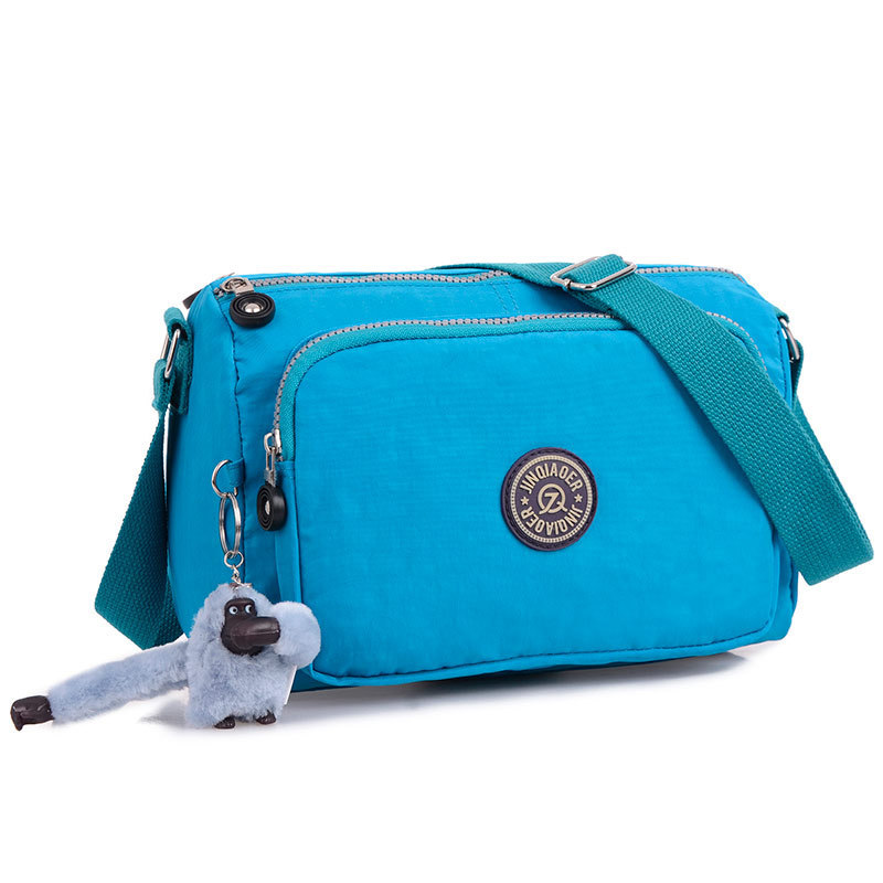 21dfbf5547 Get Quotations · New Casual women s small Messenger Bag waterproof monkey  shoulder messenger bag for ladies female nylon bolsa