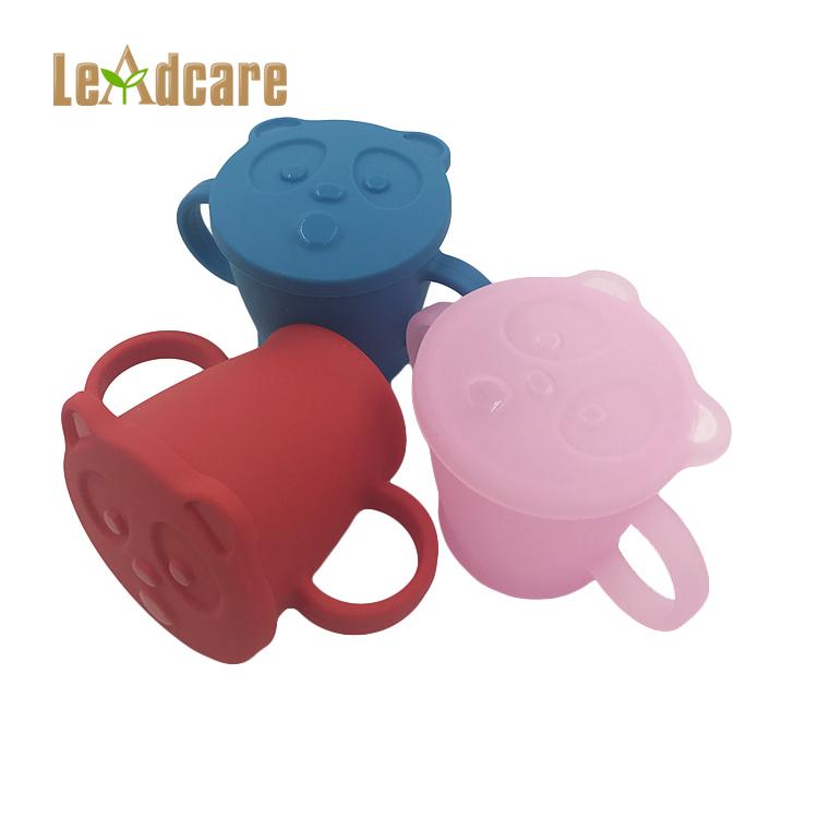 Cibo sano grado di calore-resistente agli urti-resistente di colore del silicone del fumetto di mano in possesso di bere tazza di acqua