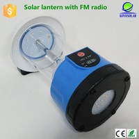 solar camping light can charge cellphone with fm radio