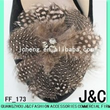 Brown feathered shoe clips