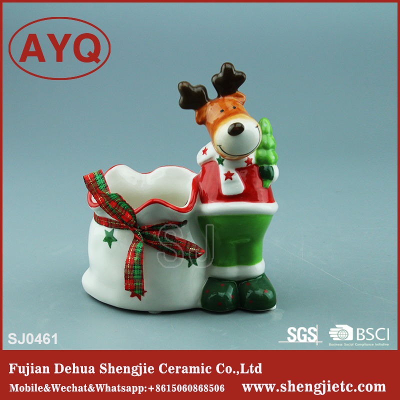 small ceramic craft deer with bag garden ornament