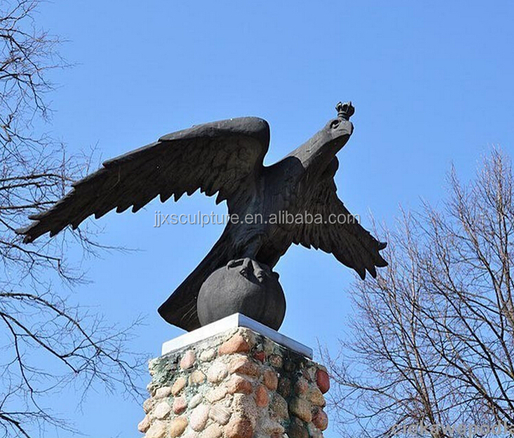bronze eagle statue with a ball