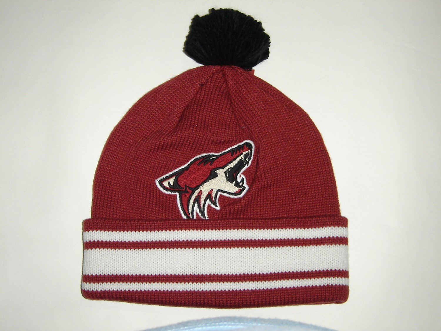 the best attitude c8ef9 1d8f7 Get Quotations · Mitchell and Ness NHL Phoenix Coyotes Logo Beanie Cuffed  Knit Hat w  Pom