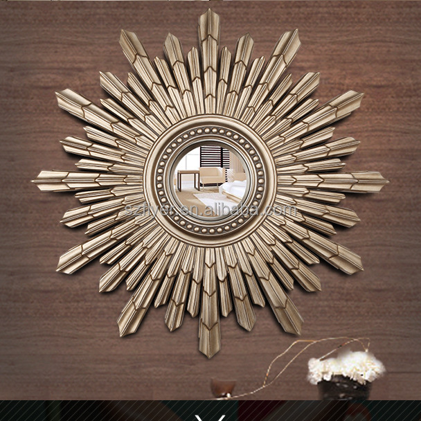 Gold color decorative sun shaped wall mirror