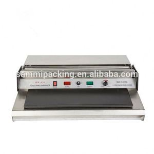 New Condition and Food Application Cling Film Wrapping Machine/automatic Liner type bottle film shrink wrapping machine