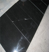 Cheap and high quality Chinese black and white marble tiles,polished marble black and white tiles blue onyx