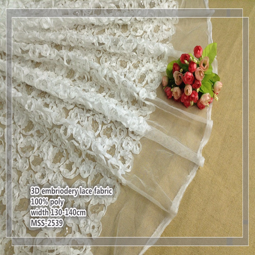 the lastest 100% polyester embroidery wedding dress fabric lace