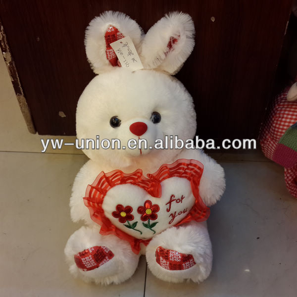 2013 white sitting and standing plush rabbit with a heart