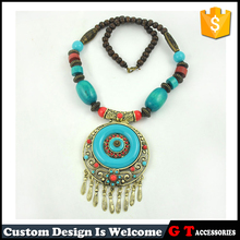 Wholesale Vintage Antique brass Beads Red Round Turquoise Pendant Necklace With Multi Alloy Small Bells Tassel