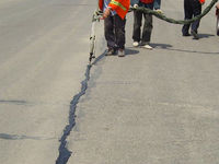 Mighty sealer, crack sealant used to repair asphalt road sealant
