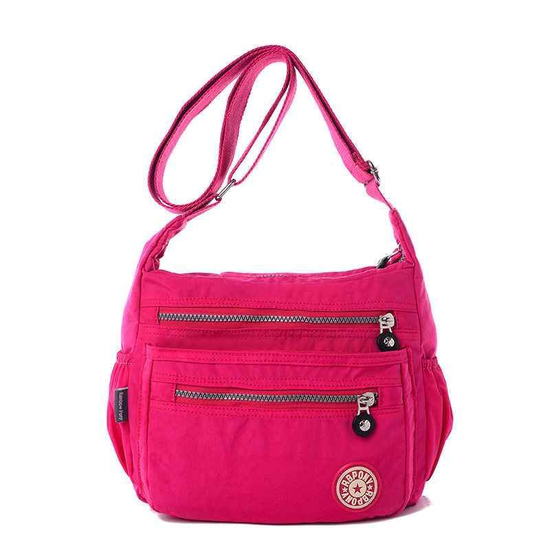 More Details Tory Burch Tilda Printed Nylon Crossbody Bag Details Tory Burch nylon crossbody bag in mixed flower and plant print. Removable top handle. Removable shoulder strap. Flap top with magnetic closure on ornamental buckle. Exterior, zip compartment under flap.