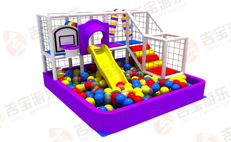 Kleine grappige kleurrijke indoor speeltuin ballenbad met glijbaan