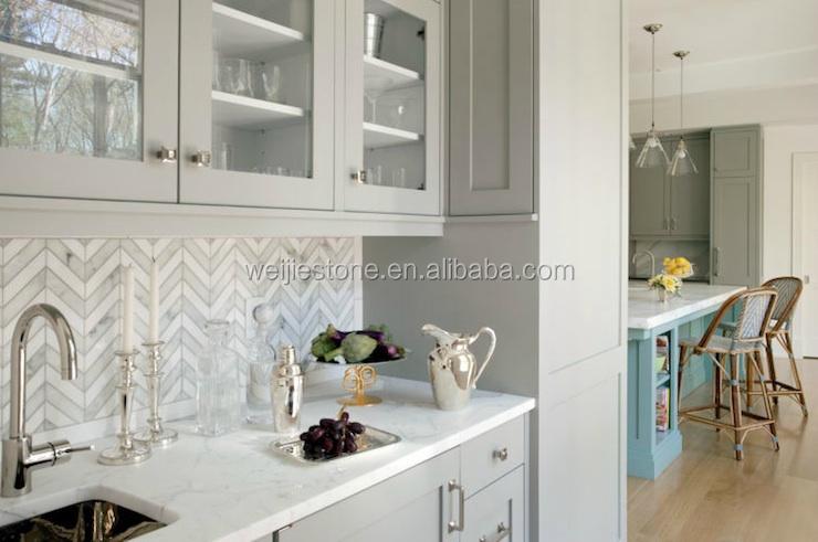 Keuken splashback en floor bianco carrara wit marmer visgraat tegel
