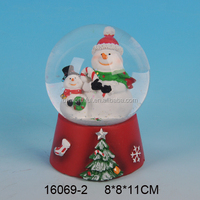 Decorative ceramic snow globe with blowing snow for wholesale