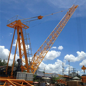 The new derrick crane for dismantling internal climbing tower cranes from high buildings