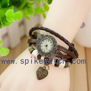 Wristwatch with heart shaped ornament multiple strap watch