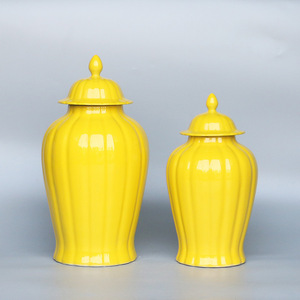 General Ceramic Jar with yellow and pumpkin design carving