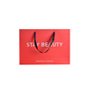 /product-detail/wholesale-fashion-red-color-sliver-stamping-logo-paper-bag-659120856.html