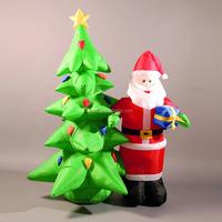 small image of inflatable santa and christmas tree