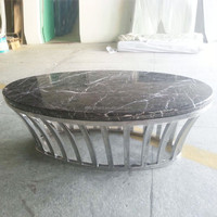 wrought iron table with marble top with stainless