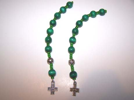 Green wooden bead pocket rosary with silver celtic cross.