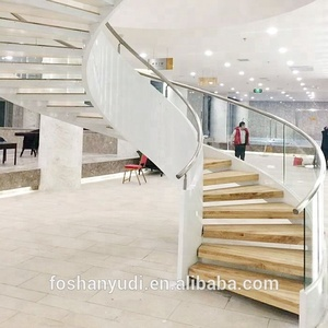 Indoor low cost curved steel wood staircase design with glass railing